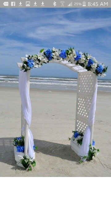Dwan Wedding Arch With More Tulle Over Royal Blue Lights Under