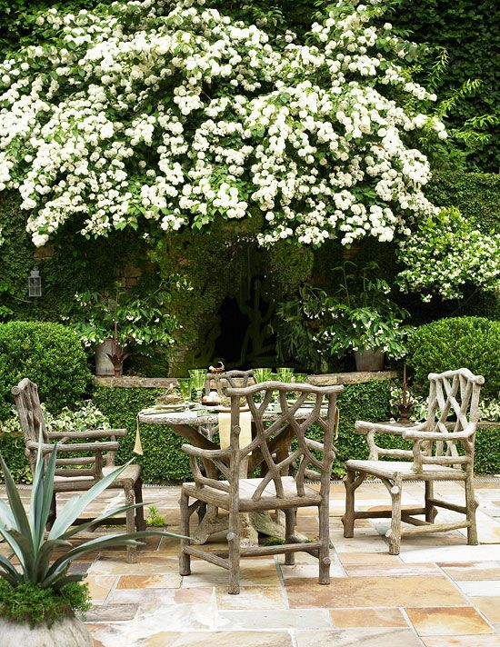 Charming Southern Patio: This Atlanta Patio Reads Casual Southern Comfort  Underneath Boughs Of White Blooms. Natural Wooden Furniture Speaks To The  ...