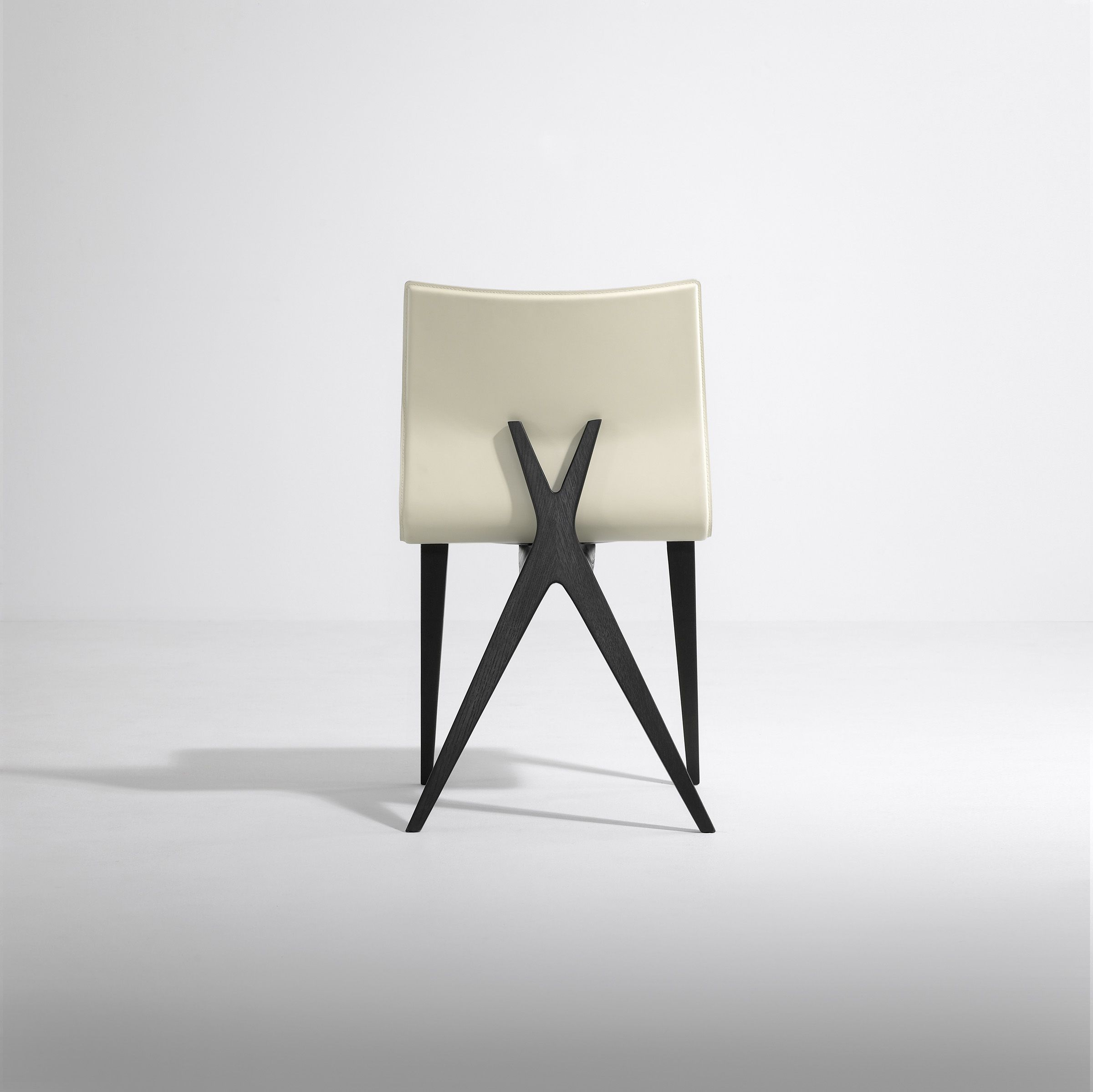 A beautifully minimal dining chair the Eco Leather X Chair is