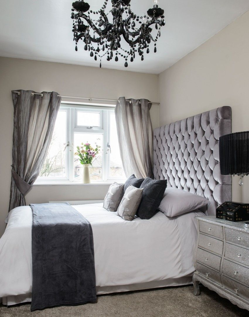 Beau Neutral Bedroom With Black Chandelier And Padded Headboard