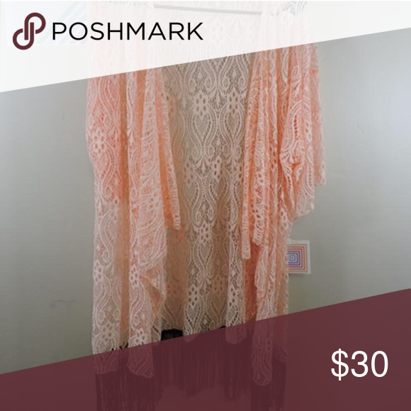 Lularoe Monroe Lace Kimono New with tags Lularoe Monroe Kimono, never worn! Size Large, beautiful lace in a pale pink color (almost peachy) with black fringe! Was too big for me but I bought it anyway because it was too gorgeous to not!!! 😍❤️️ LuLaRoe Tops