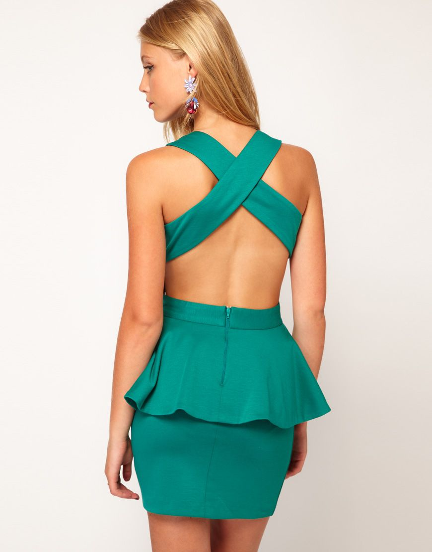 Love the color of this asos peplum cut out dress new year new