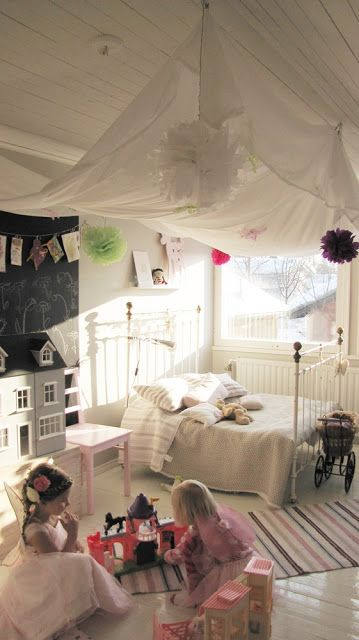 A sweet girls room.  Iron bed.