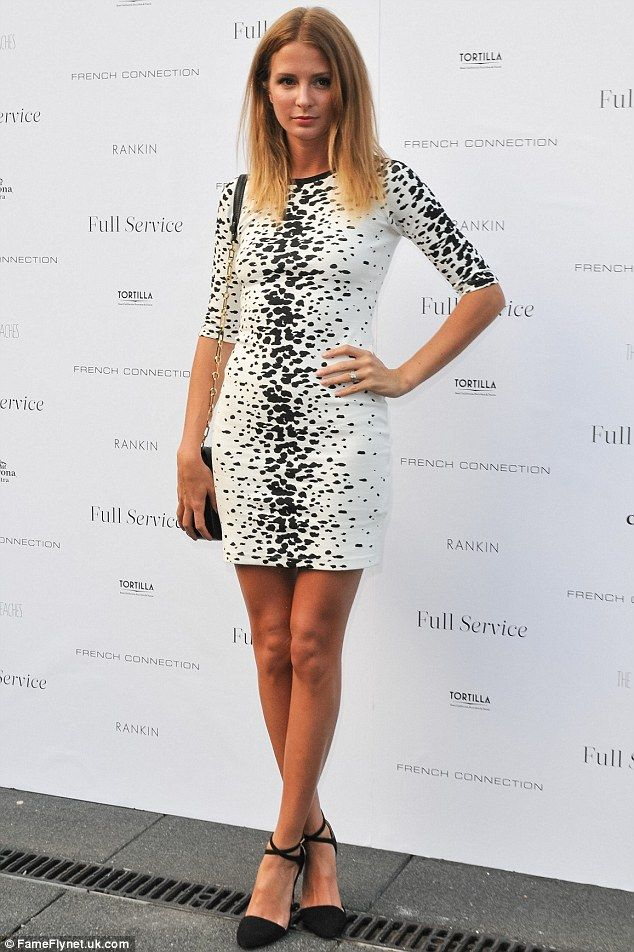 dc734a1b241 Tanned and toned: Millie Mackintosh looked tanned in a white spotted dress  at the French Connection party in North London