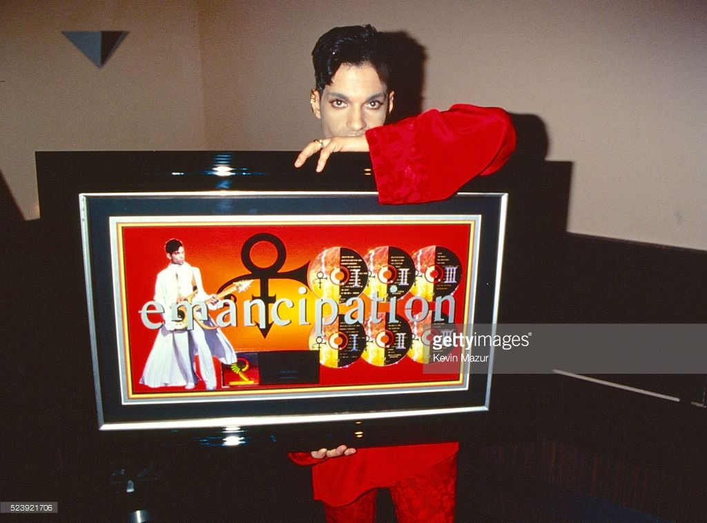 Prince (1958-2016) poses during his 'Emancipation' album release party at Life on February 27, 1997 in New York City.