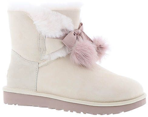 UGG® Gita (Women s) Water- and stain-resistant twin face leather upper with  fixed satin bow and sheepskin pom-pom detailing. Water- and stain-resistant  ... 867825d02