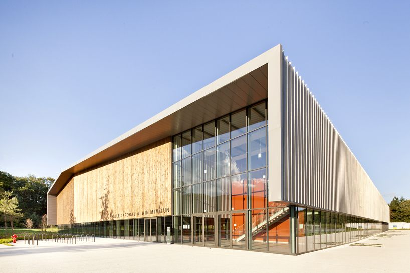 barthelemy & grino's sports halls echo the forest's lines