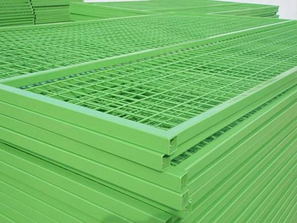 Several grass green color Canadian temporary fencing panels in the