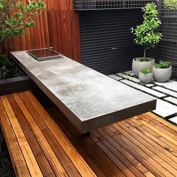 Amazing floating outdoor dining table and driveway platforms all finished. designed by @acre_studio and landscaped by @signature_landscapes  #concretebenchtop #insituconcrete #insituconcretebenchtops #concretefurniture #hardscape #smegbbq #bespokeconcrete #outdoorlifestyle by hungrywolfstudio