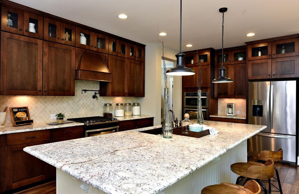Kitchen with dark cabinets and large serving