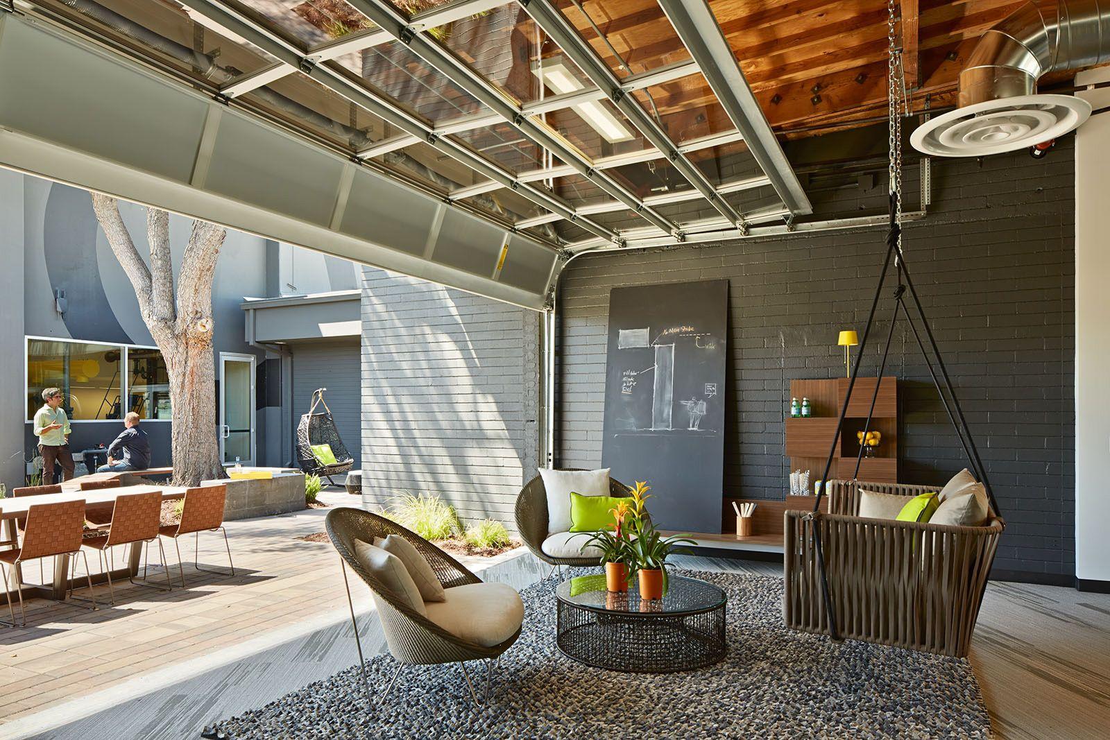 One workplace outdoor office with open garage breakout area garage doors glass garage door
