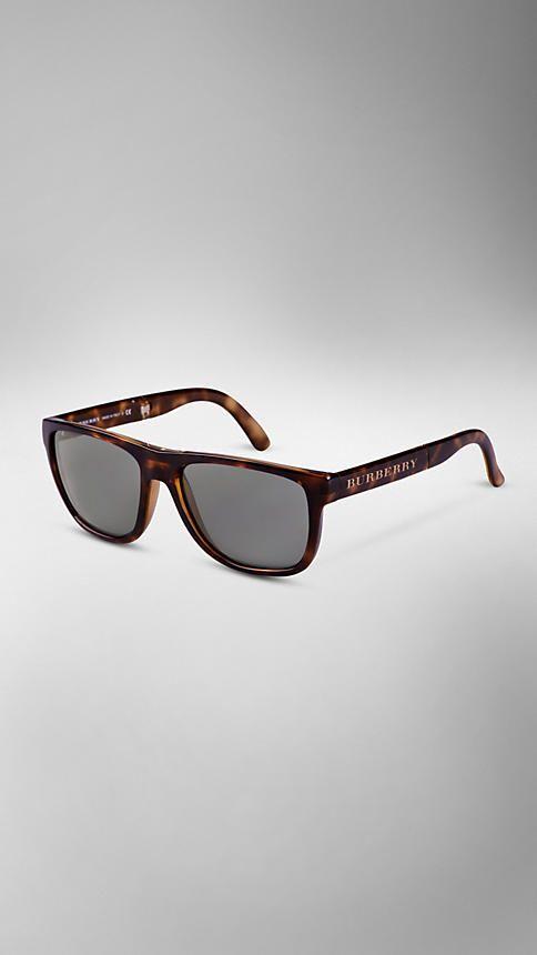 6c4dc36b9b Burberry -- Tortoiseshell sunglasses that are foldable.