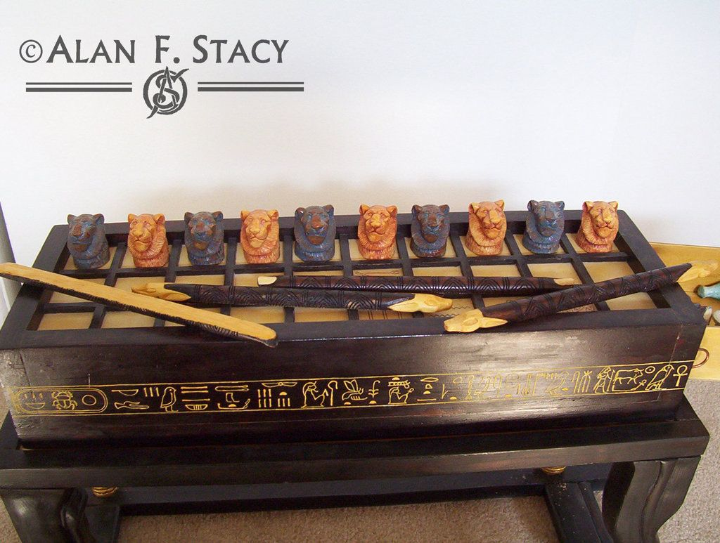An accurate reproduction I did of the largest of the senet game or Game of Thirty Squares sets found in King Tutankhamun's tomb. The box and sledge with lion shaped legs are of pine, the playing bo...