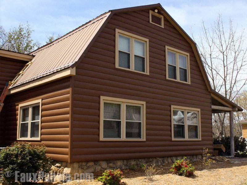 Log Cabin Siding Made From Durable Vinyl, Installed On A Home In Spice  Color.