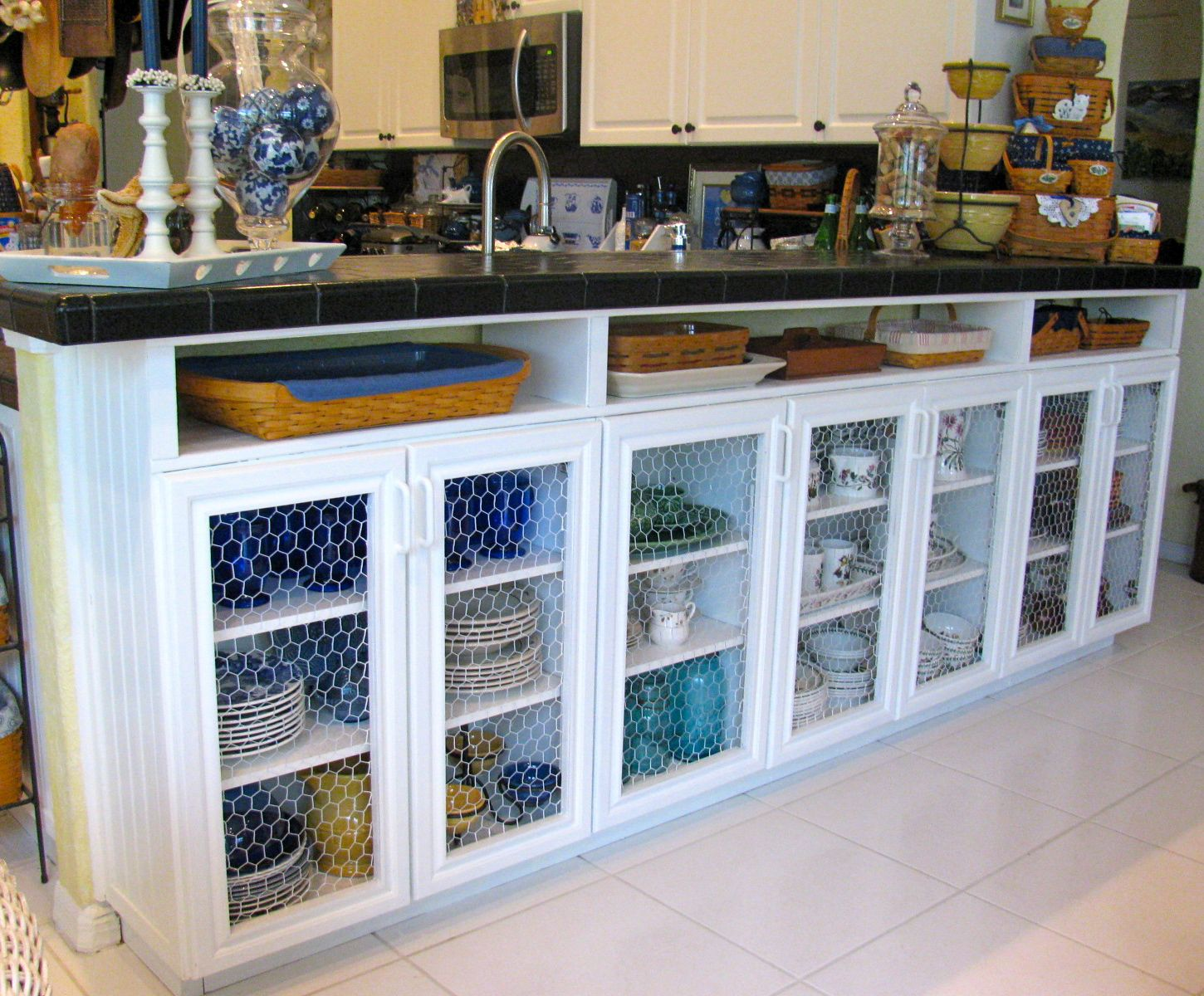 I could try this with some pre fab ikea shelves under our Kitchen under cabinet storage ideas