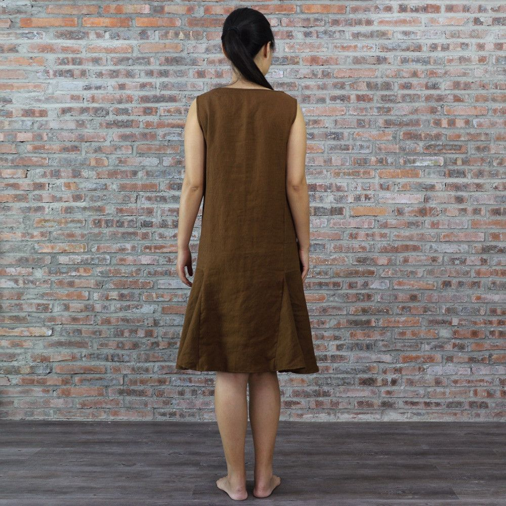 A pure linen sleeveless shift dress offers comfort & classic grace, in knee length with V-neck, drop waist & front pleats in Earth-tone French flax. Order now!