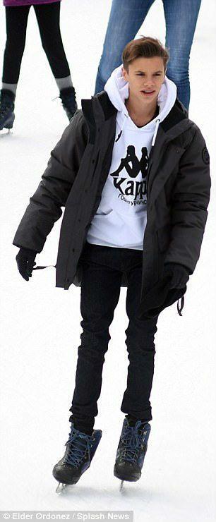 Cute Romeo Beckham Ice Skating In A White Kappa