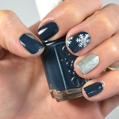 Navy and Silver Snowflake Nail Design