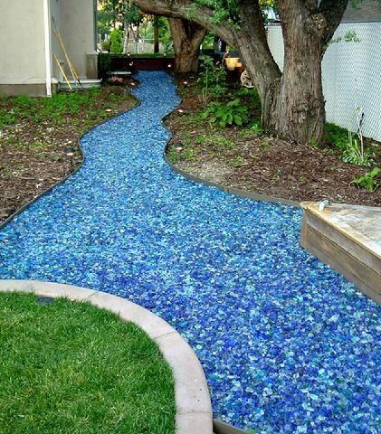 Superior Garden Ideas · Glass Mulch  So Creative! #glass #glassmulch #decorative  #creative #lawn