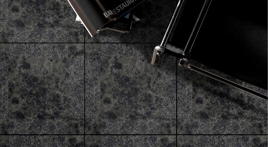 Waldorf Black Floor Tile - A unique modern black marble effect ceramic floor tile. This gloss marble effect tile has a smooth flat surface in the centre with a subtle riven border. The marble veins will vary from tile to tile to create the appearance of natural marble.
