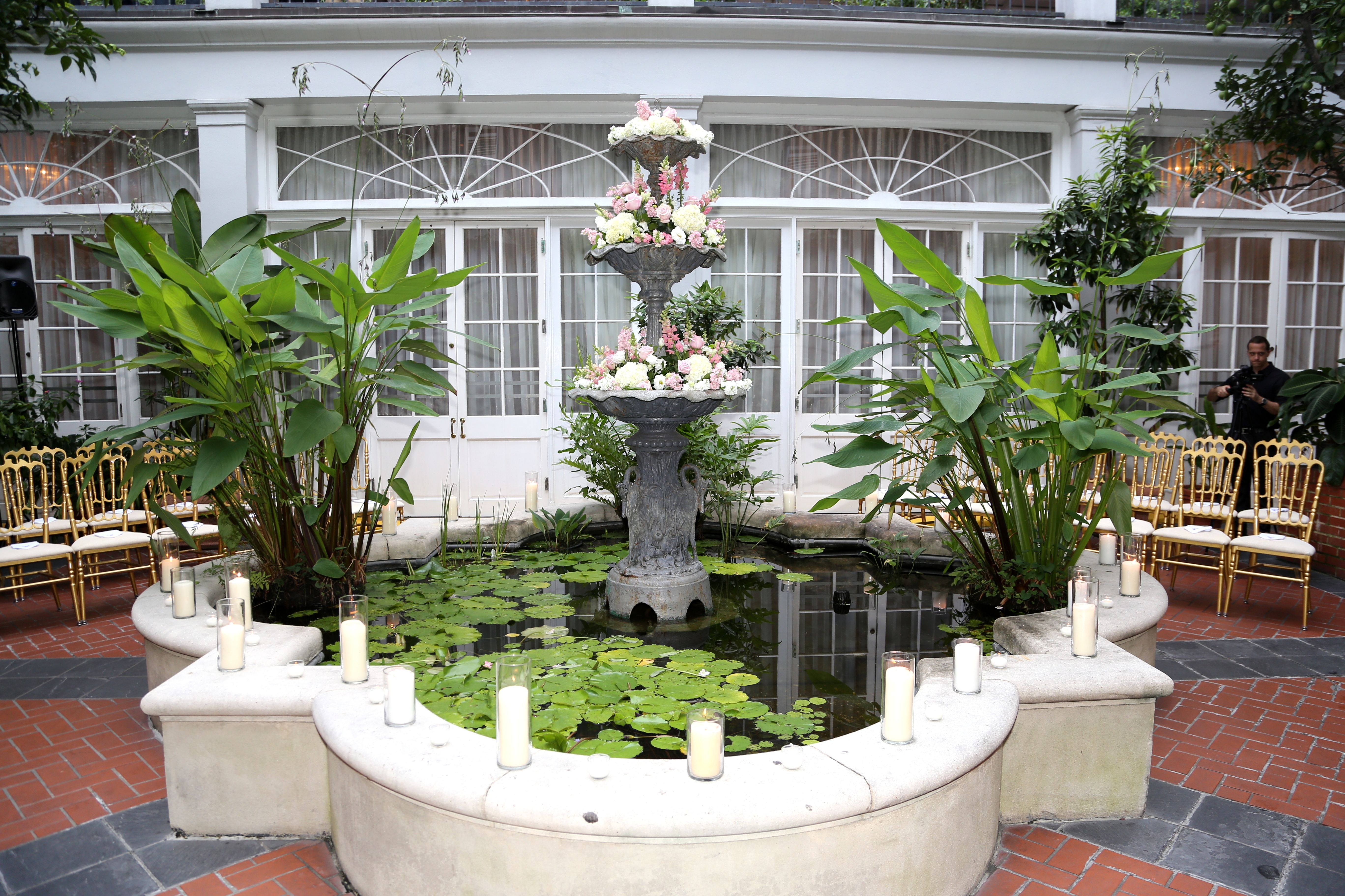 Fountain courtyard wedding at royal sonesta hotel altar