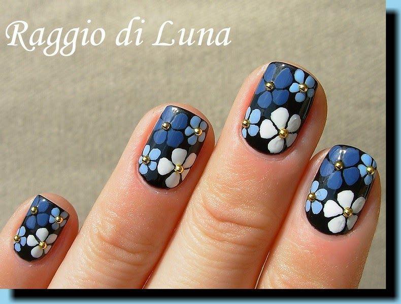 Blue and white flowers on black (Raggio di Luna Nails)   Nail nail ...