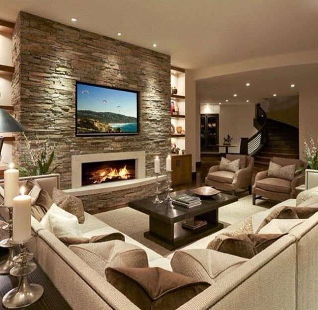 Accent Wall With Shelving On Each Side And Accent Lighting
