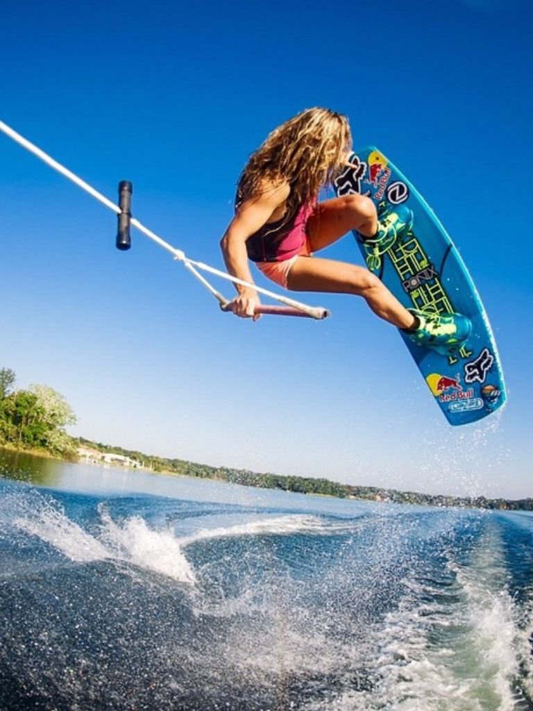 wakeboarding  wakeboarding chick getting some air on her