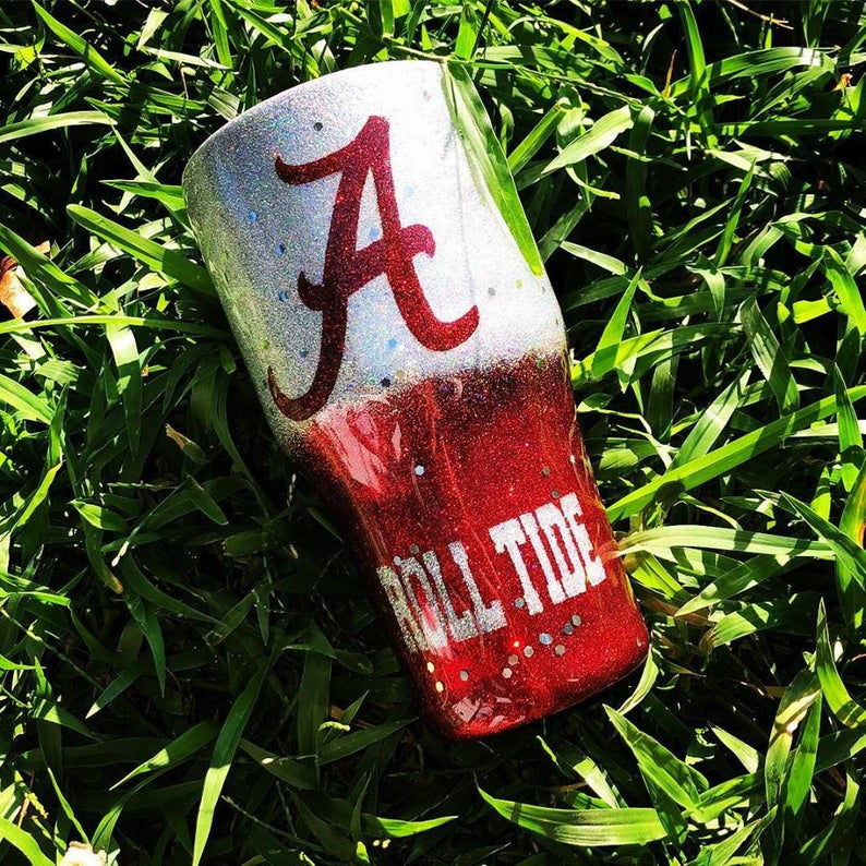 Alabama glitter tumbler, glitter cup, roll tide, Alabama tumbler #rolltidealabama Alabama lover? Then this is the tumbler for you!  All tumblers for this listing come like the image shown above.  ****Please message us directly If you anything specific you would like that is not listed in my photos before placing your order!  All tumblers and decals are coated with FDA compliant sealer for a smooth, glass like shine that will keep the decal from peeling with normal everyday use. Each tumbler is s #rolltidealabama