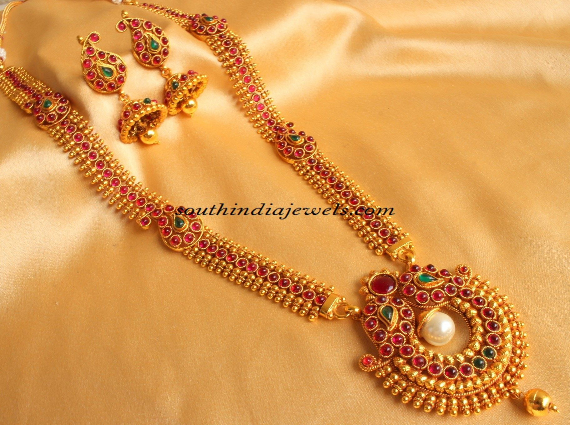 d3c2774e4 This is a imitation jewellery from Dreamjwell jewellers. Long mango mala  haram studded with kemp stones, pearls and tiny golden balls.