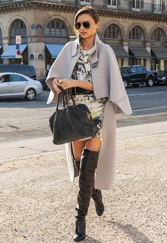 Miranda Kerr wearing a cape with over-the-knee boots