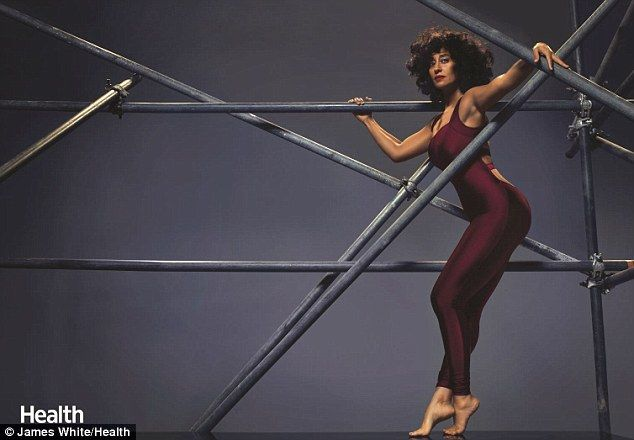 Tracee Ellis Ross flaunts her trim figure wearing formfitting activewear in this month's i...