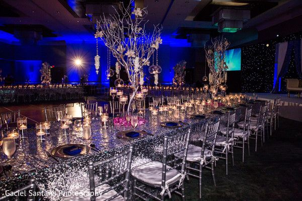 Unique indian wedding reception table decor. http://www.maharaniweddings.com/gallery/photo/91702