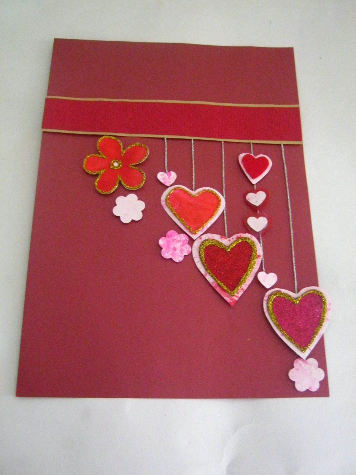 How to make scrapbook with construction paper - Make Scrapbook Pages For Your Valentine Using Marbled Paper Heart Cut Outs Create