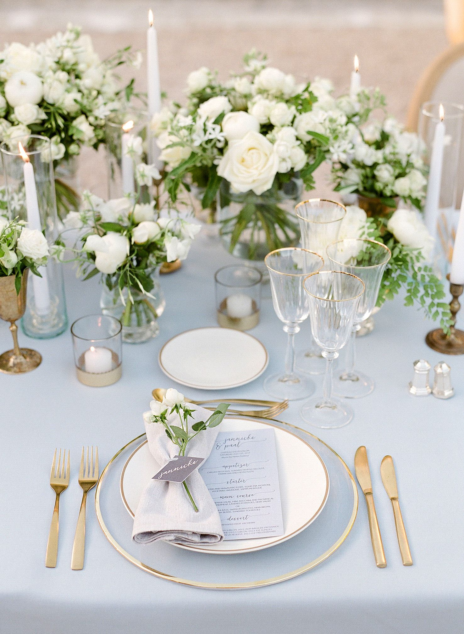 The delicate place settings included glass chargers