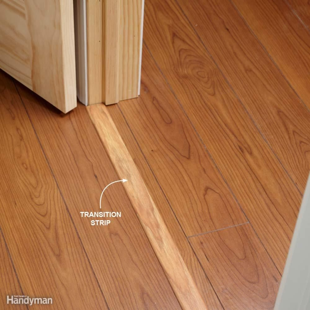Use transition strips under doors if you 39 re installing for Wood floor pieces