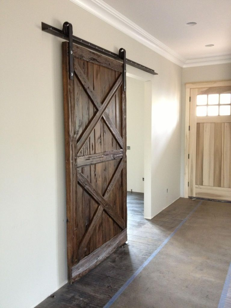 Double x pattern mushroom wood sliding barn door barn for Hanging a sliding barn door