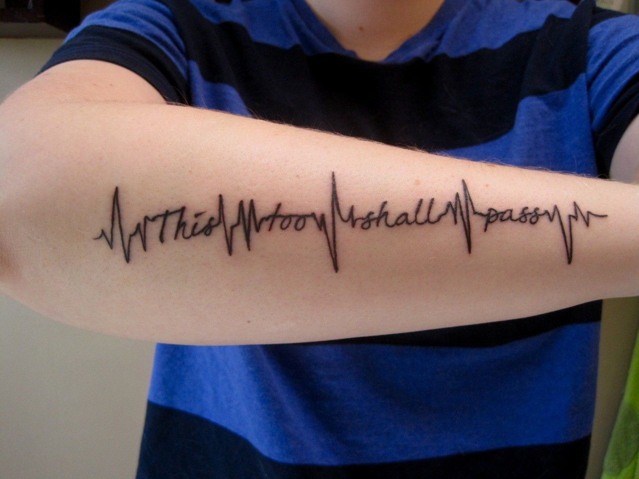 unusual life heartbeat tattoo quotes on lower arm this