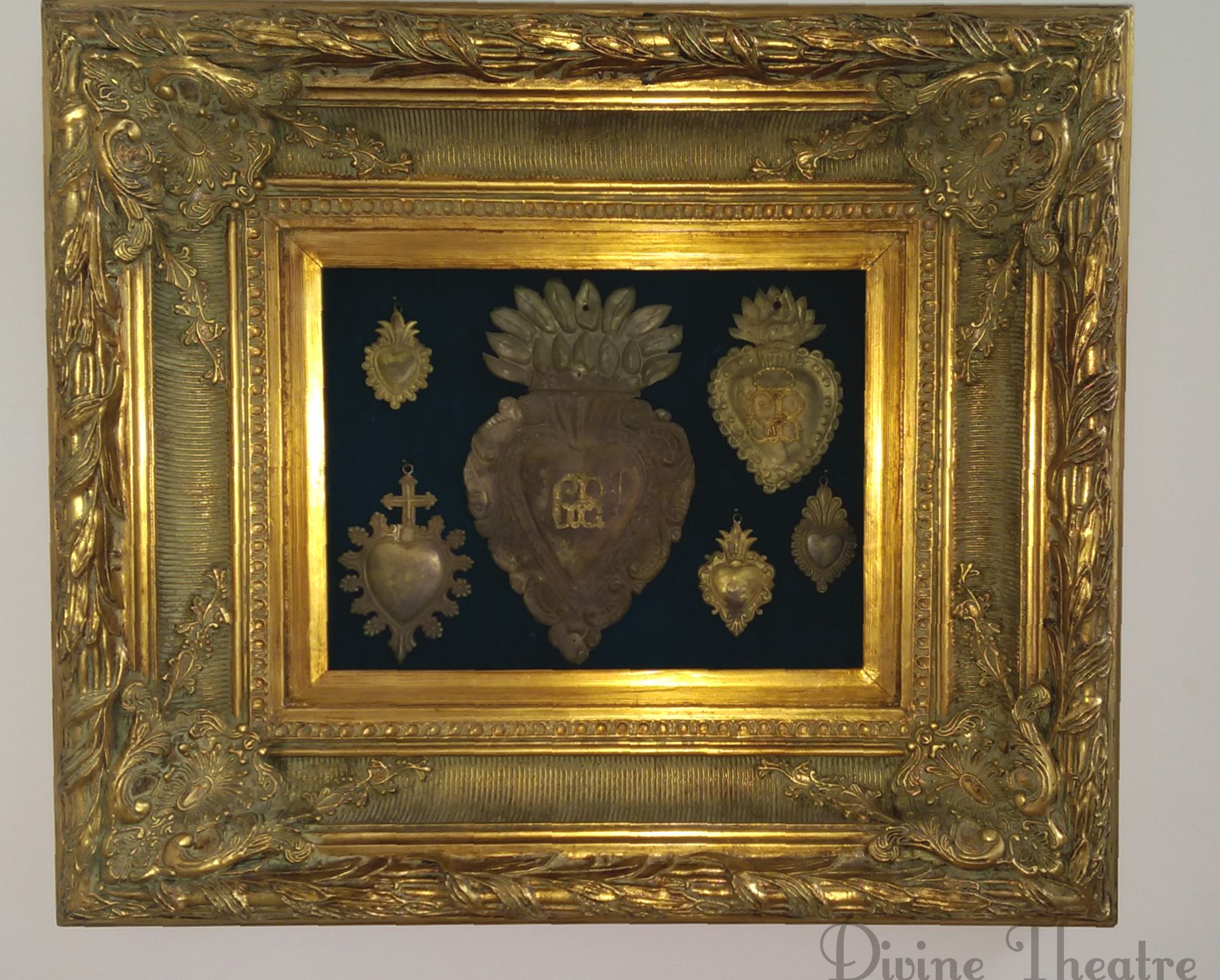 """The Latin term ex voto (short for ex voto suscepto, """"from the vow made"""") designates a Catholic votive offering placed in a church or shrine in thanksgiving for a miracle received."""
