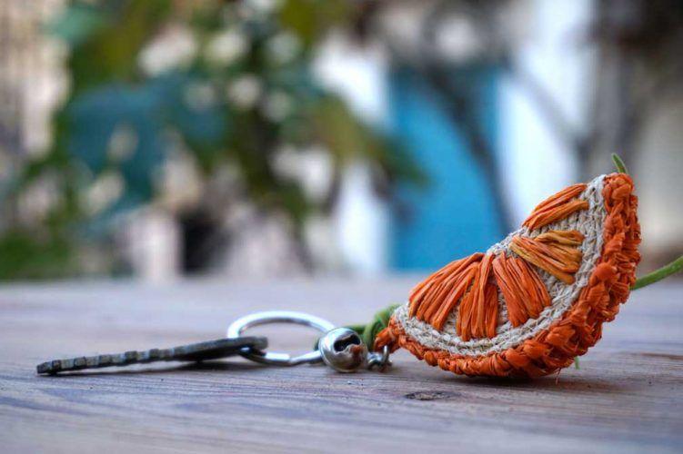 keychain orange braided from natural Raffia