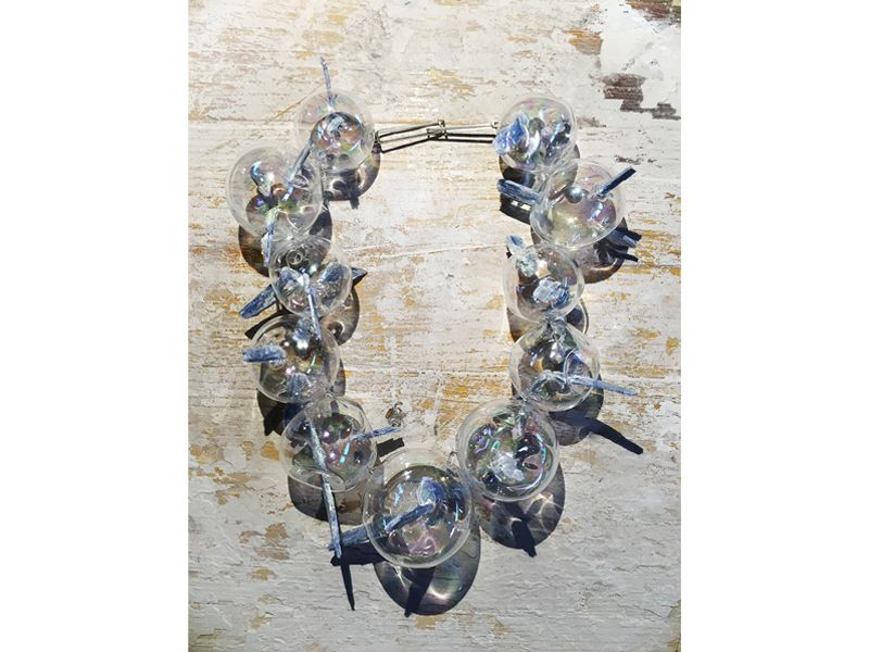 """Federica Sala, Unbearable Lightness, 2015, neckpiece, glass, cyanite, silver, blown glass, 200 x 200 x 70 mm, photo: Paulo Ribeiro   FEDERICA SALA, UNBEARABLE LIGHTNESS, 2015 Selected by Paulo Ribeiro, director and founder of JOYA Barcelona Art Jewellery Fair (Spain) """"Fragility and strength are the main concepts of Federica Sala's Unbearable Lightness collection. She creates necklaces that are extremely fragile, but at the same time pushes the limits of the material, as the combination of…"""