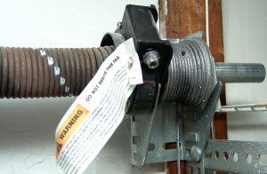 How To Replace Garage Door Torsion Springs Garage Door Torsion Spring Garage Door Spring Replacement Garage Door Springs