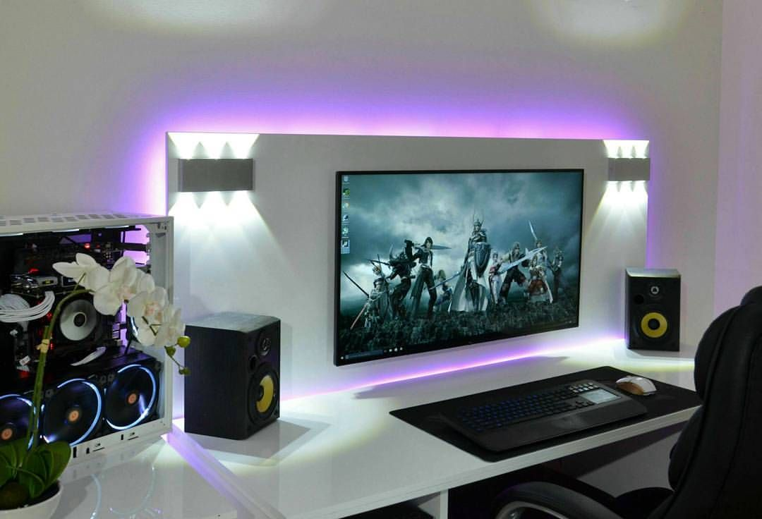 Extremely clean PC gaming setup with cool lighting a nice