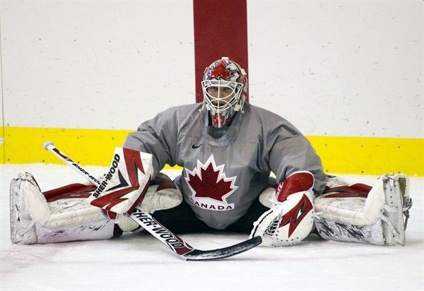 Canadas goaltender Martin Brodeur stretches Wednesday, Feb. 17, 2010 during the mens ice hockey team practice at the 2010 Vancouver Winter Olympic Games in Vancouver. THE CANADIAN PRESS/Ryan Remiorz