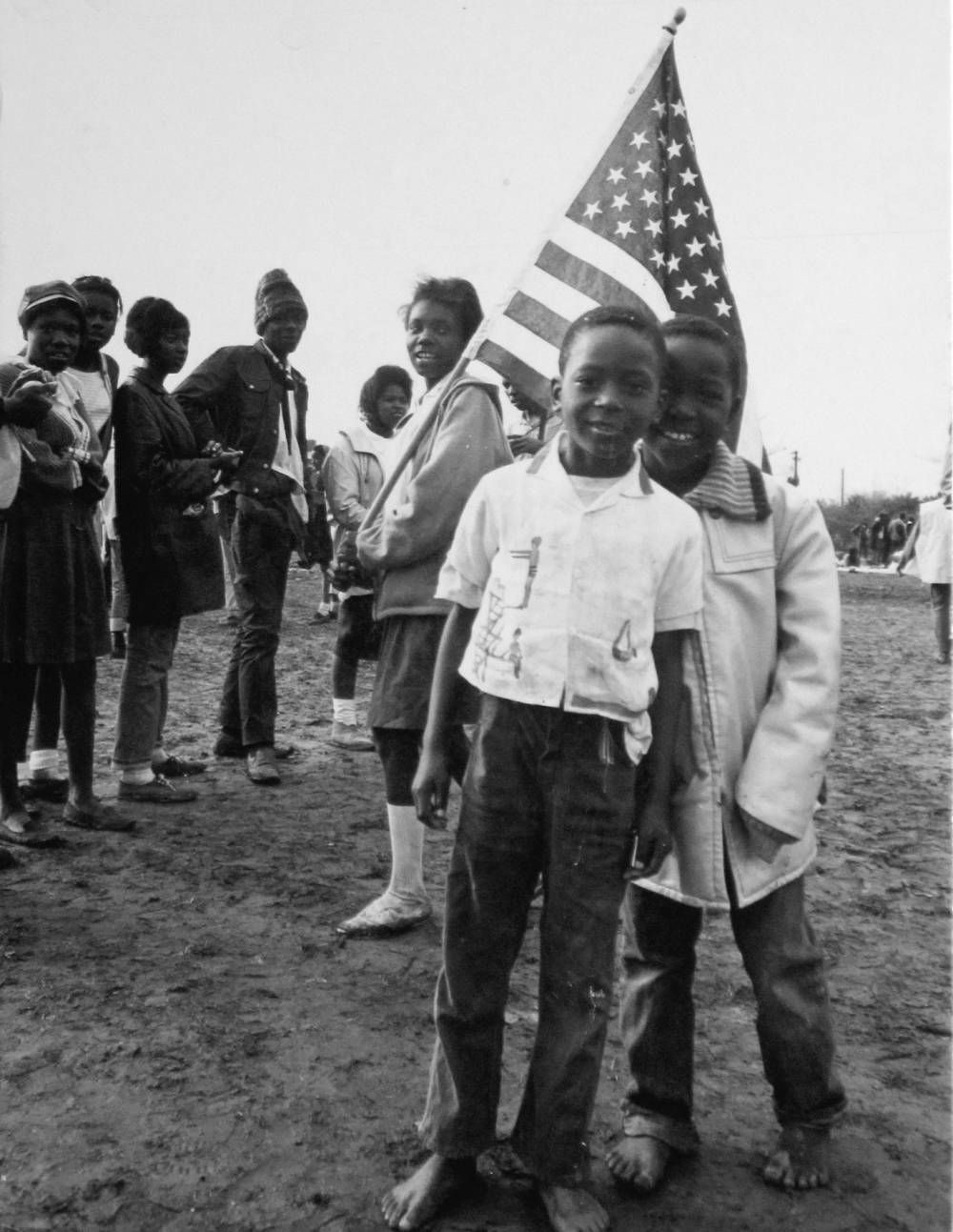 Untitled (Boys with Flag), 1965. Photograph by Dennis Hopper.