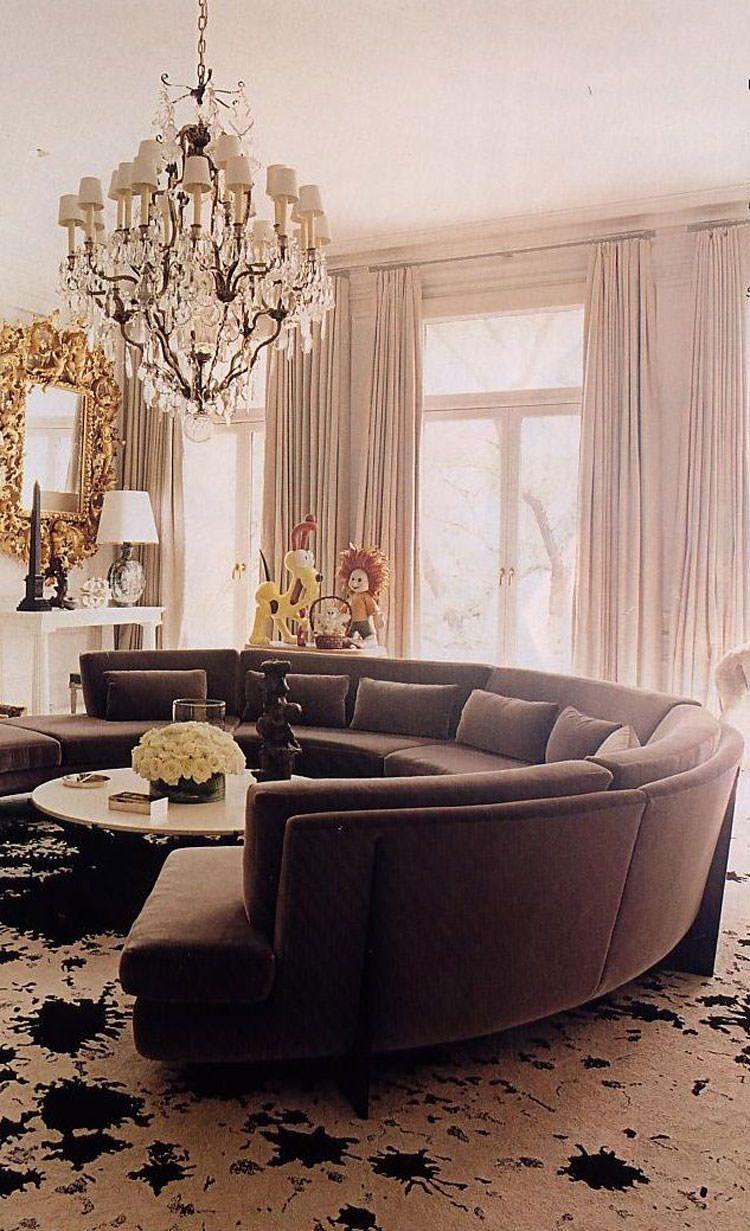 31 esempi di arredamento con divani rotondi divano curvo for Divano rotondo