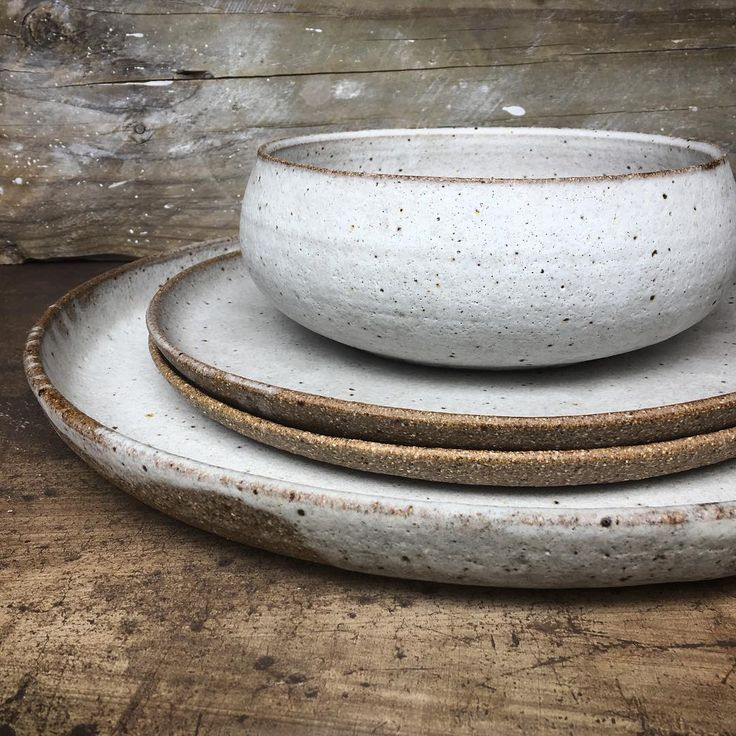 """Lisa Russell on Instagram: """"Big platter, dinner plates and a serving bowl all in a chalky white glaze. #lunaceramics #tableware #handmade #white #simple #minimal"""""""