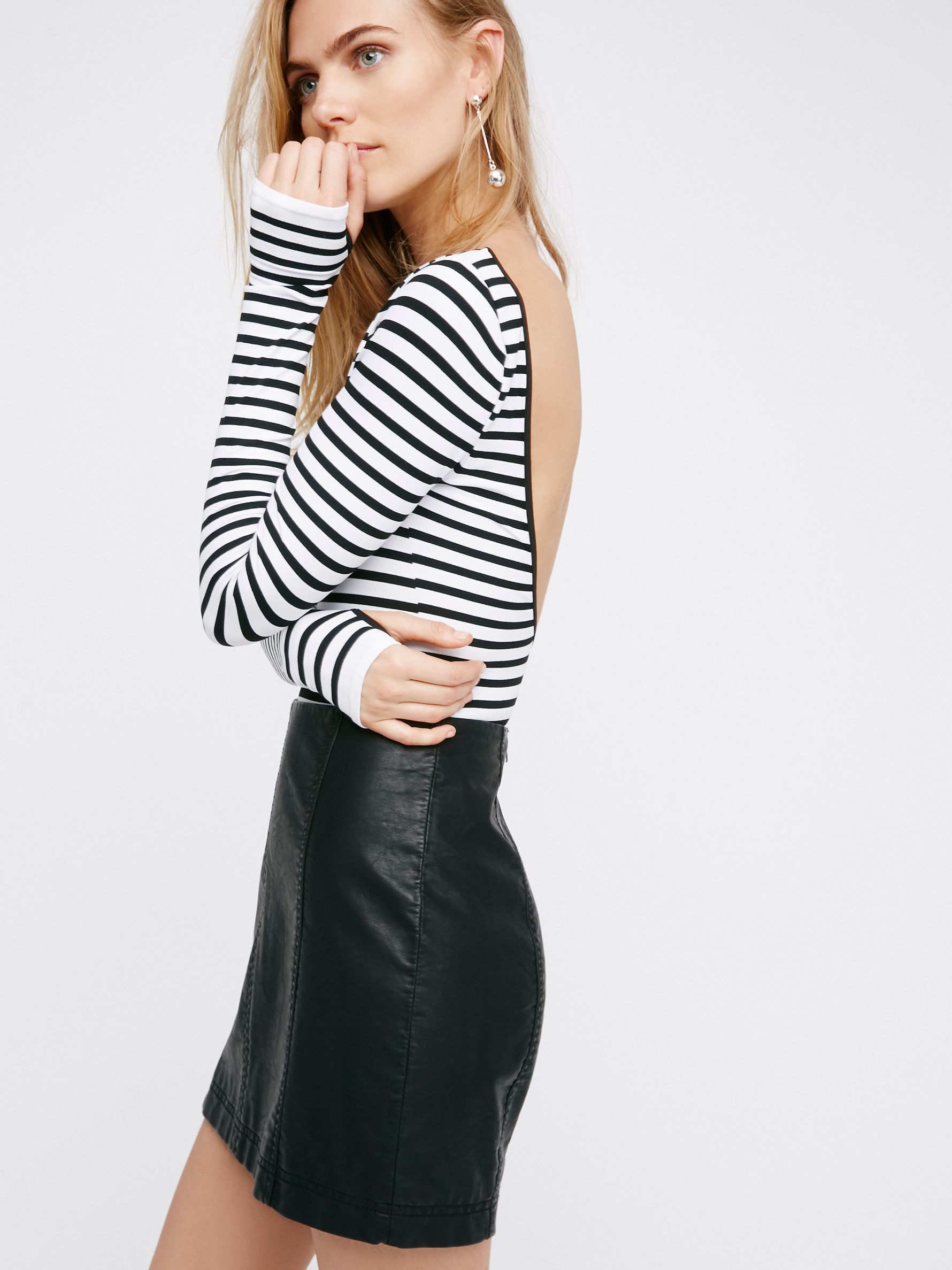 Modern Femme Vegan Mini Skirt | In a clean and sophisticated silhouette this mini skirt is easily dressed up or down. Exposed back zip. Lined.