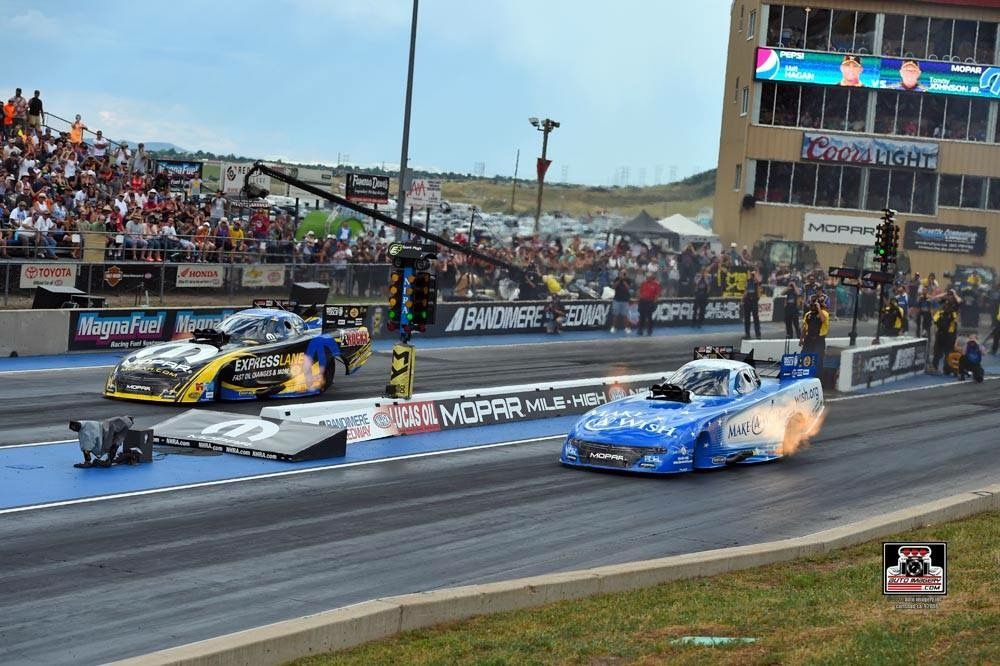 Tommy Johnson JR Pilots the Make a wish foundation T/F Funny Car with DSR Team at The Mopar Mile High Nationals.