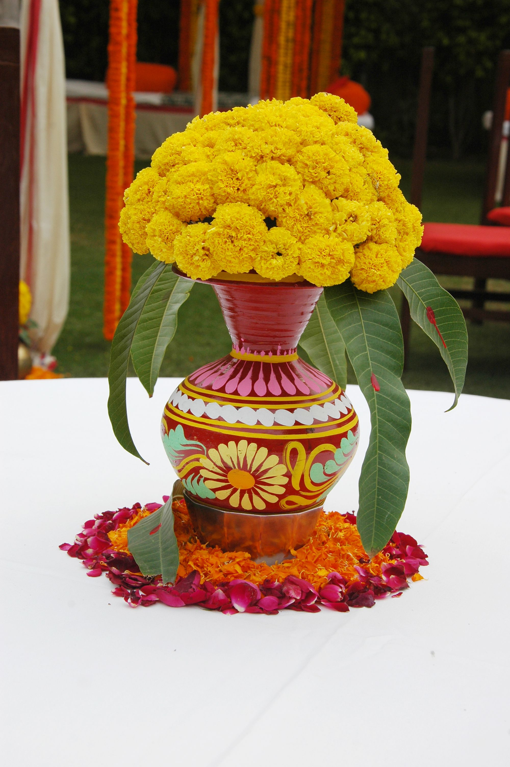 Wedding decorations simple  Pot with simple easily available bright yellow flowers wedding